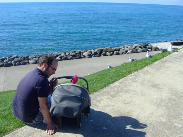 SBJ and his dad on our last day in New Plymouth, looking out to the Tasman Sea