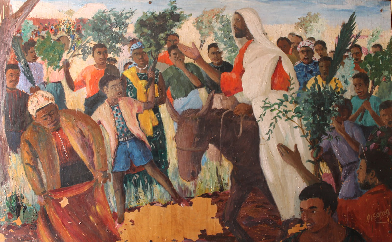 An African Jesus triumphal entry into Jerusalem riding on a donkey to the enthusiasm of the crowd