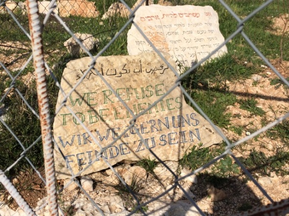 'We refuse to be enemies.' Stone on a Palestinian Christian farm. Photograph by Chris Chamberlain. | Sacraparental.com